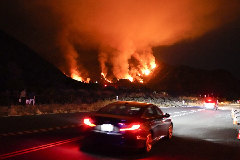 The heat wave isn't just straining the power grid. It's fueling fires, such as this blaze on Aug. 13 in Azusa.