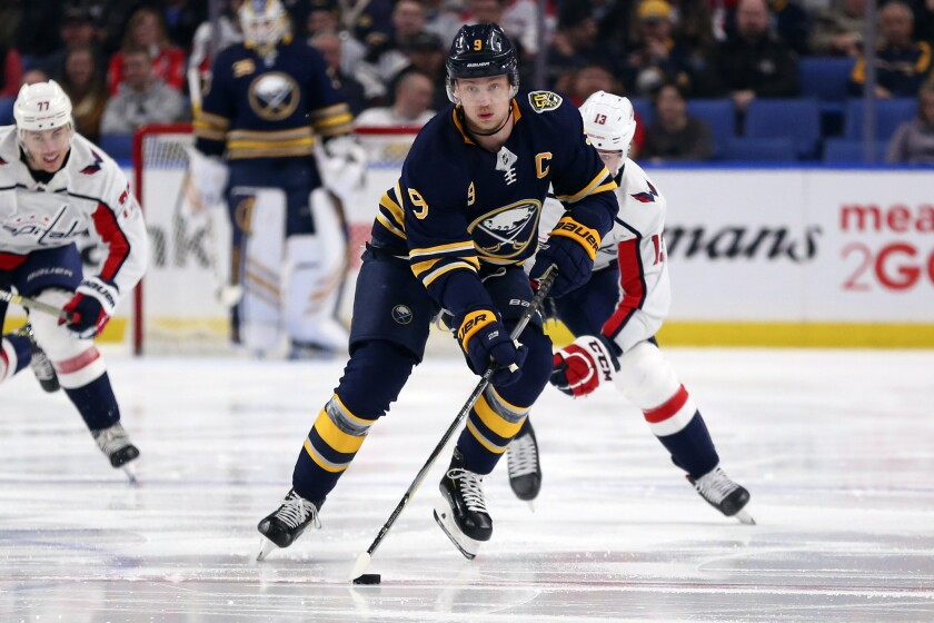 FILE - In this March 9, 2020, file photo, Buffalo Sabres forward Jack Eichel (9) carries the puck during the first period of an NHL hockey game against the Washington Capitals in Buffalo, N.Y. Rather than focusing on his first NHL draft as a general manager, Kevyn Adams was busy re-assuring the Sabres fanbase he has no intention of trading Eichel or have any concerns the captain wants out. (AP Photo/Jeffrey T. Barnes, File)
