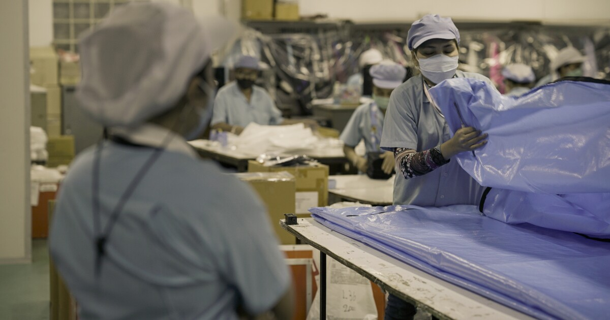 The global journey of a COVID-19 body bag - Los Angeles Times