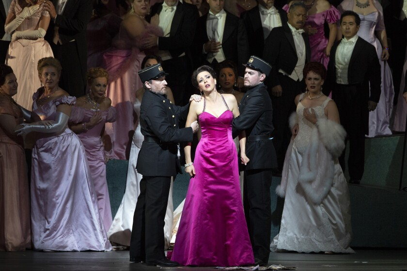 """This photo released by the Metropolitan Opera shows soprano Lisette Oropesa as the fortune-hunting heroine in a revival of Massenet's """"Manon"""" at The Metropolitan Opera in New York. (Marty Sohl/Metropolitan Opera via AP)"""