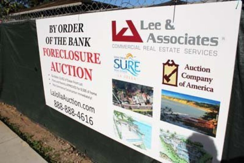 The sign remains above the property on Torrey Pines Road, which has gone into escrow. Photo: Dave Schwab