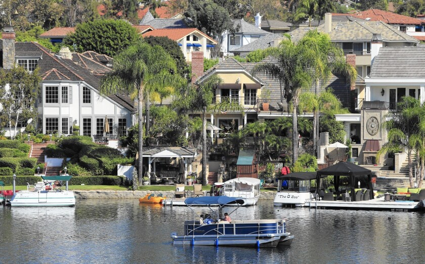 Homeowners' equity holdings nationwide are up sharply and interest rates are near historical lows, leading to more home equity borrowing. Above, homes in Mission Viejo.