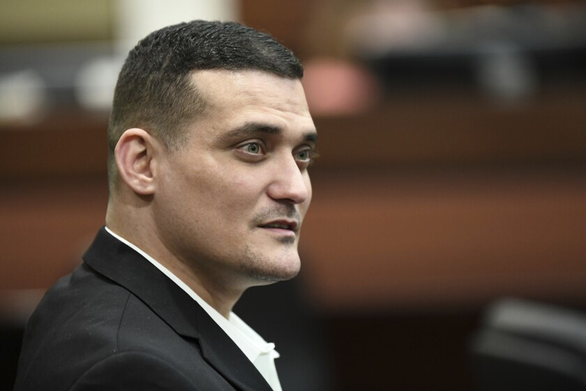 Sigfredo Garcia talks with Katherine Magbanua as they wait for Judge James C. Hankinson to enter the courtroom Friday, Oct. 11, 2019 in Tallahassee, Fla. Magbanua and Garcia are charged in the 2014 murder of Florida State law professor Dan Markel. (Alicia Devine/Tallahassee Democrat via AP)