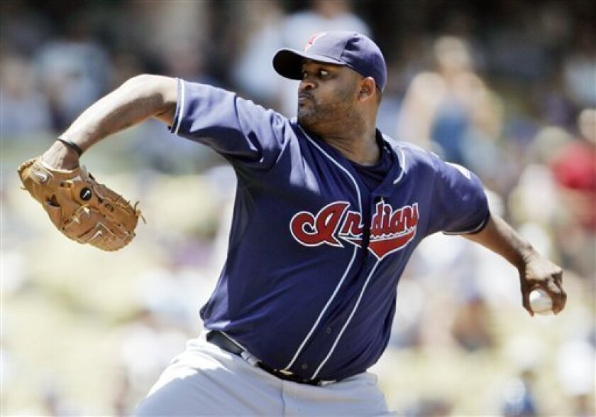 Cleveland Indians starter C.C. Sabathia pitches to the Los Angeles Dodgers in the first inning of an interleague baseball game in Los Angeles, Saturday, June 21, 2008. (AP Photo/Reed Saxon)