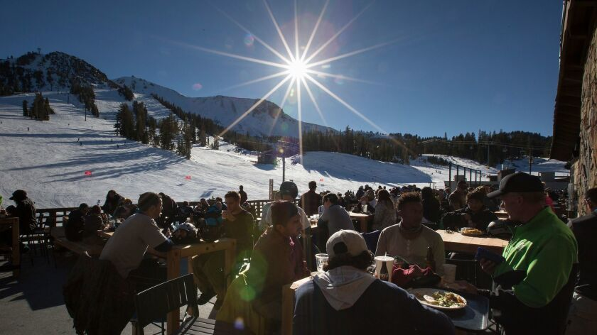 Skiers and snowboarders fill Tusks Bar at the base of Mammoth Mountain in Mammoth Lakes on Dec. 3, 2016. Ski resort operators are expecting a near-record season with higher ticket prices.