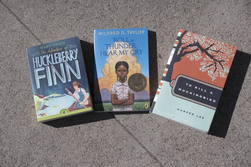 """Copies of removed books """"The Adventures of Huckleberry Finn,"""" """"Roll of Thunder, Hear My Cry"""" and """"To Kill a Mockingbird."""""""