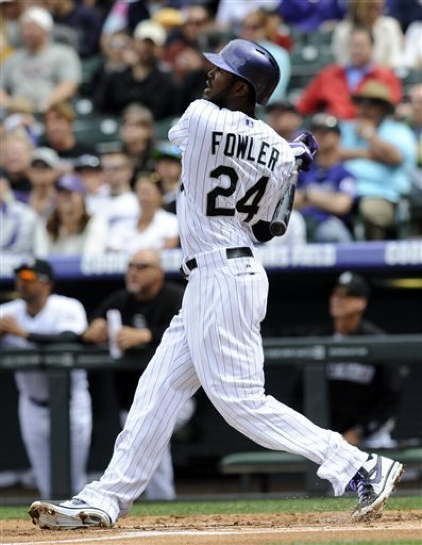 Colorado Rockies' Dexter Fowler (24) hits a two-run home run off San Diego Padres starting pitcher Edinson Volquez during the first inning of a baseball game on Sunday, April 7, 2013, in Denver. (AP Photo/Jack Dempsey)