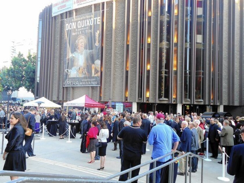 """San Diego Opera patrons gather at the Civic Theatre in downtown San Diego before a performance of """"Don Quixote."""""""