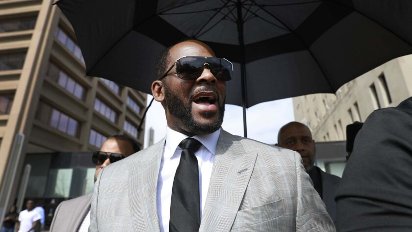 R. Kelly leaves the Leighton Criminal Court building in Chicago in June.