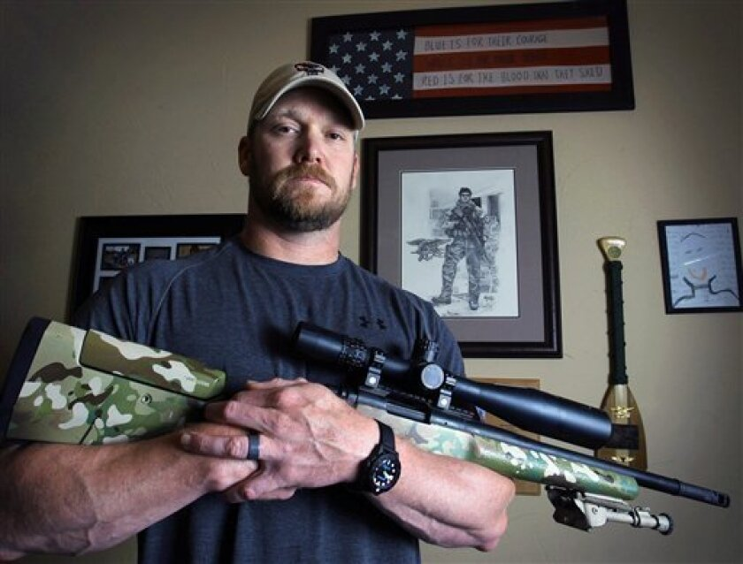 """FILE - In this April 6, 2012 file photo, Chris Kyle, a former Navy SEAL and author of the book """"American Sniper,"""" poses in Midlothian, Texas. Kyle and his friend Chad Littlefield were fatally shot at a shooting range southwest of Fort Worth, Texas, on Saturday, Feb. 2, 2013. Former Marine Eddie Ray"""