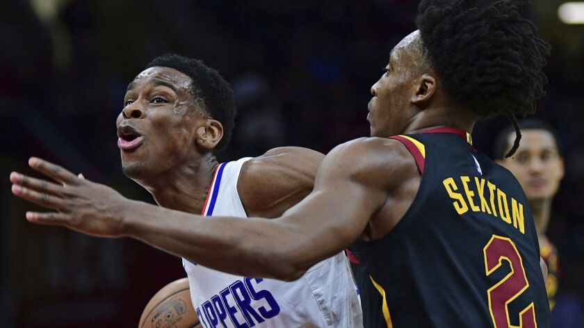 Los Angeles Clippers' Shai Gilgeous-Alexander drives against Cleveland Cavaliers' Collin Sexton in t