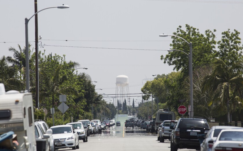 A tower in mostly industrial Vernon looms over a leafy neighborhood in Maywood.
