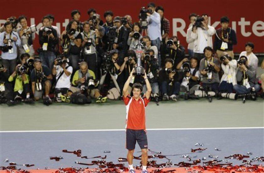 Kei Nishikori of Japan holds the trophy after defeating Milos Raonic of Canada in their final match at the Japan Open tennis championships in Tokyo, Sunday, Oct. 7, 2012. Nishikori won the match 7-6, 3-6, 6-0. (AP Photo/Koji Sasahara)