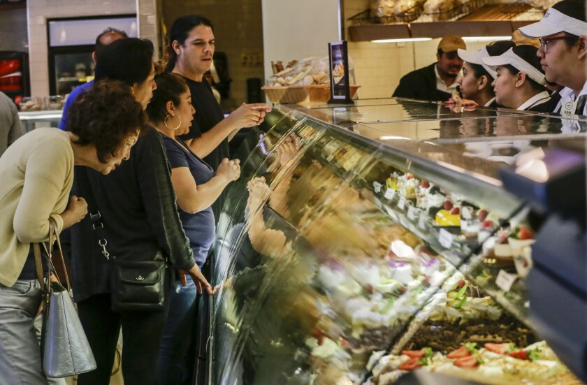 Shoppers peruse the pastry case at Porto's Bakery & Cafe in Glendale.