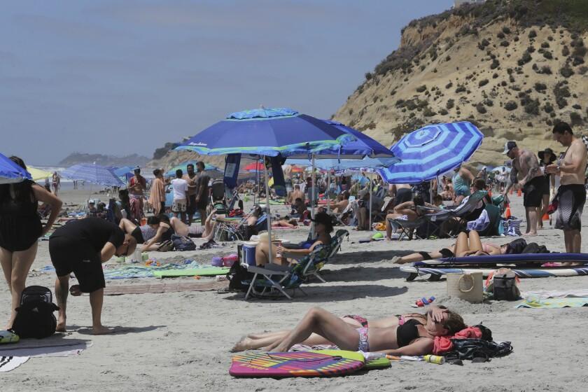 Beachgoers Thursday, 06/03/20, at Solana Beach. photo by Bill Wechter