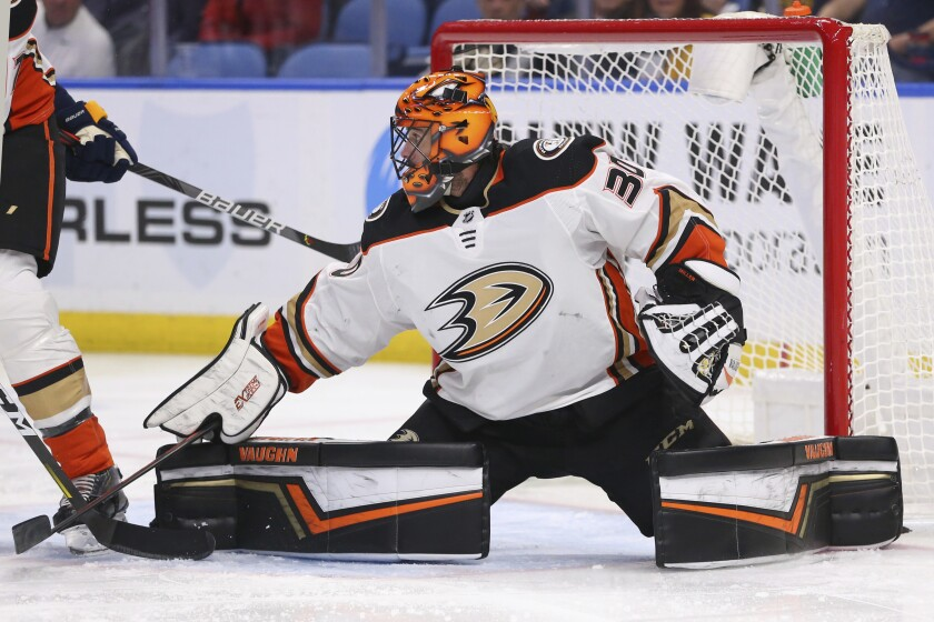 Anaheim Ducks goalie Ryan Miller (30) makes a pad-save during the first period of an NHL hockey game against the Buffalo Sabres, Sunday, Feb. 9, 2020, in Buffalo, N.Y. (AP Photo/Jeffrey T. Barnes)