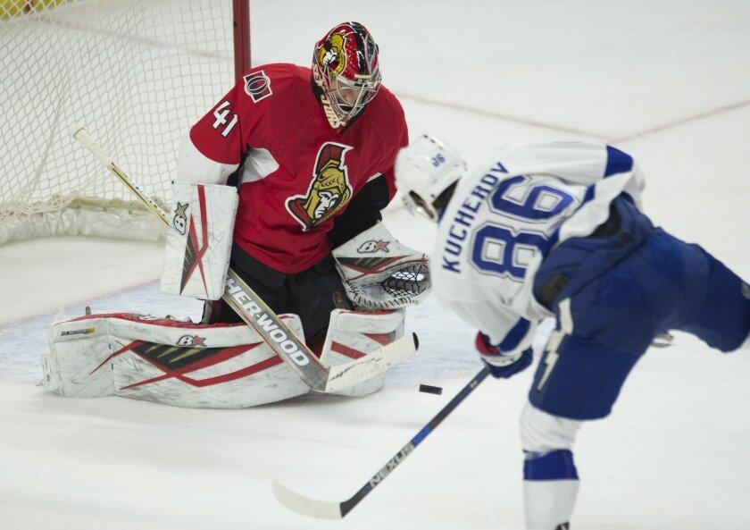 Tampa Bay Lightning right wing Nikita Kucherov (86) fires a shot on Ottawa Senators goalie Craig Anderson during second period NHL hockey action in Ottawa, Canada, Monday, Feb. 8, 2016. (Adrian Wyld/The Canadian Press via AP) MANDATORY CREDIT