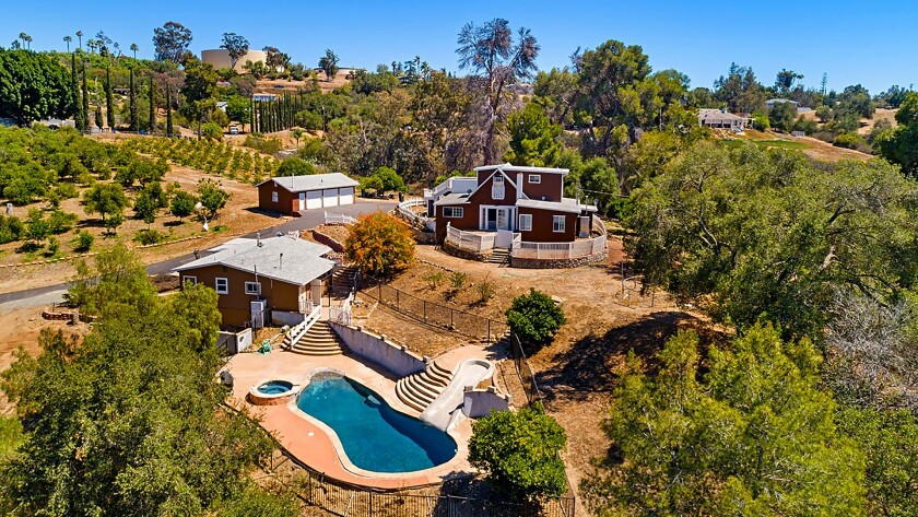 FALLBROOK: Dotted with fruit trees, this 13-acre property holds a swimming pool, spa, guest house an