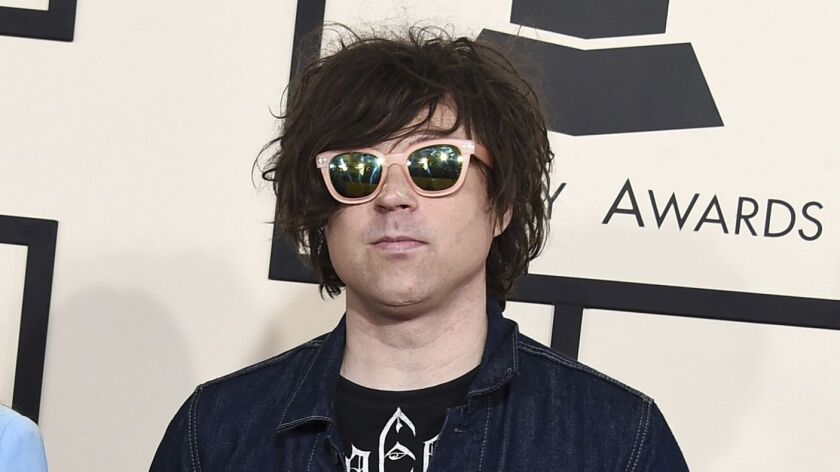 In this 2015 file photo, Ryan Adams arrives at the 57th annual Grammy Awards in Los Angeles. A New York Times report says seven women have claimed the singer-songwriter offered to help them with their music careers but then turned things sexual,