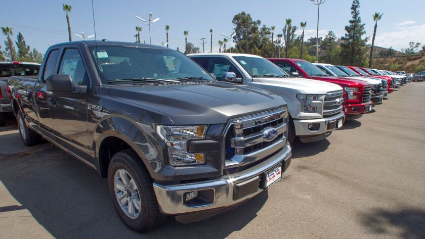 In this 2016 file photo, a large stock of Ford F-150s are parked on a lot at El Cajon Ford. Sales of pickup trucks and SUVs continued to grow in 2016 in figures compiled by California auto dealers.