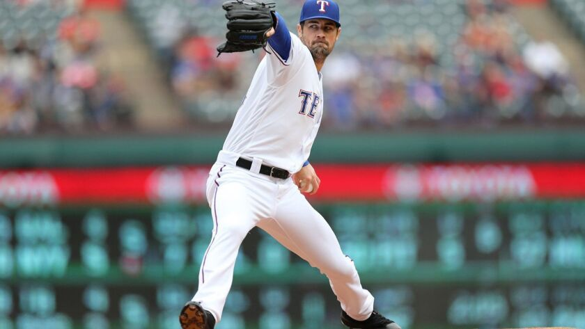 Former Rancho Bernardo High standout Cole Hamels is pitching for the Texas Rangers.