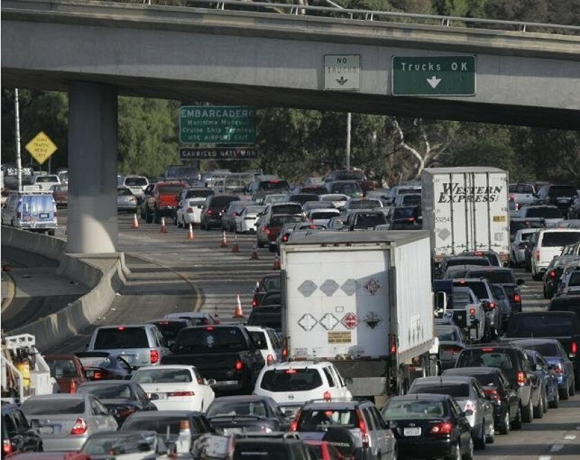 The rule would require owners of nearly 1 million trucks and buses to change out the engines in older models or install anti-pollution devices on newer ones starting in 2011.