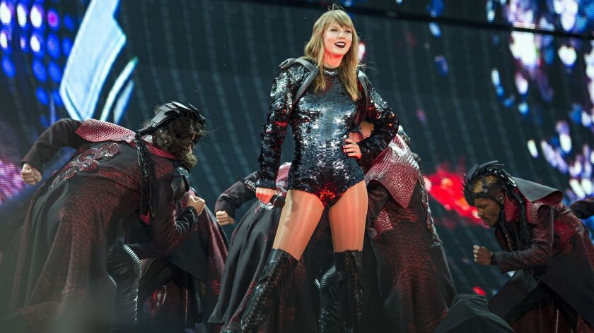 """Taylor Swift performs during """"Taylor Swift's Reputation Stadium Tour"""" in Louisville, Ky. A film version of the """"Reputation"""" tour -- filmed at the AT&T Stadium in Arlington, Texas, -- is available on Netflix."""