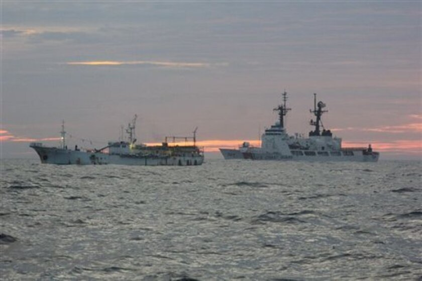 In this undated photo provided by the United States Coast Guard, the crew of the Kodiak based Coast Guard Cutter Munro monitors the Bangun Perkasa, a stateless fishing vessel suspected of illegal large scale high seas drift net fishing on Friday, Sept. 30, 2011 in Alaska. When Coast Guard crews boarded the ship about 2,600 miles southwest of Kodiak, they found 30 tons of squid and 30 shark carcasses aboard. Francis says workers tried to dump more than 10 miles of net, but it was retrieved. (AP photo/United States Coast Guard)
