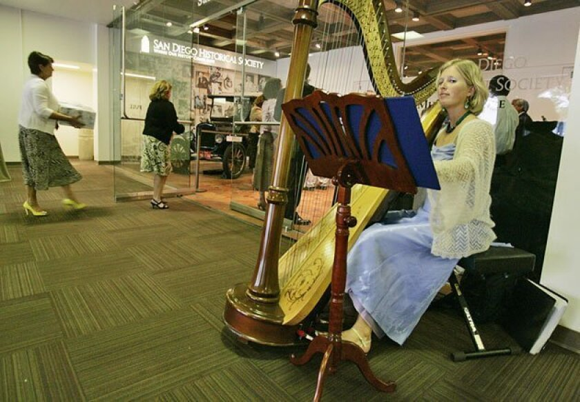 Harpist Laura Vaughn played as guests arrived at the Hendren-Kiesling reception. (Peggy Peattie / Union-Tribune)