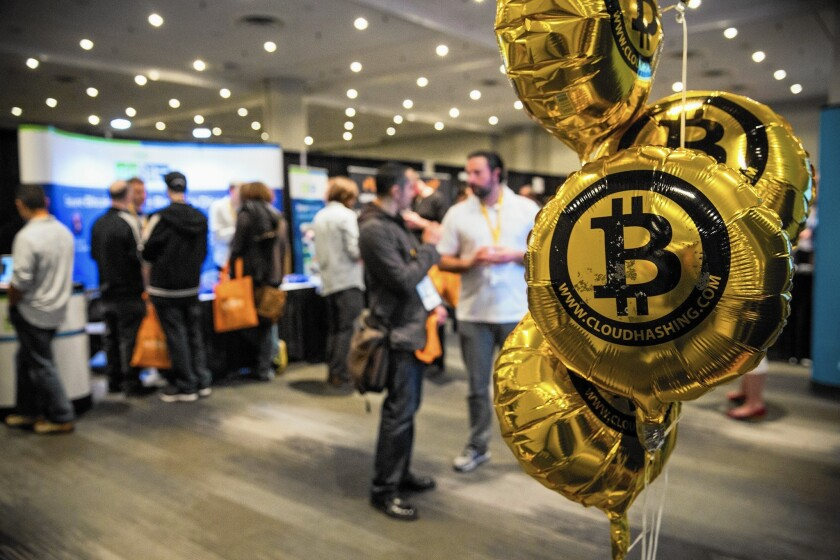 The value of a bitcoin surged to more than $400 last week from its low this year of $177.28 in mid-January. Above, people attend a Bitcoin conference in New York in 2014.