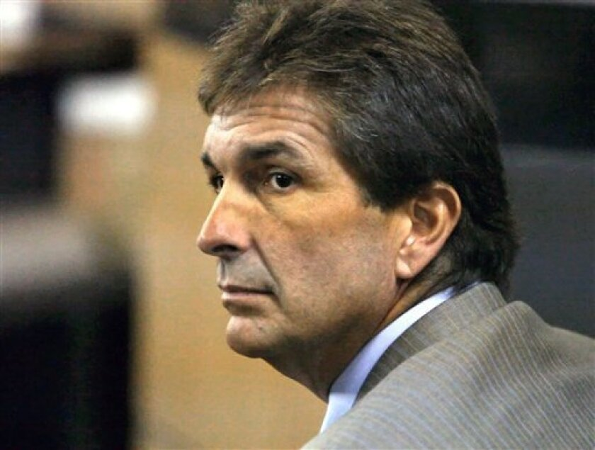 In a July 21, 2010 photo, John Goodman, accused of running a stop sign in his Bentley convertible and killing 23-year-old Scott Patrick Wilson, appears in court in West Palm Beach, Fla. Goodman, 48, recently adopted his 42-year-old girlfriend. Critics say he is trying to maintain some indirect control over money he fears could be awarded to the family of Wilson. Goodman goes on trial next month in that death, accused of drunken driving manslaughter. The victim's family has also sued Goodman in a civil case. (AP Photo/Palm Beach Post, Lannis Waters)