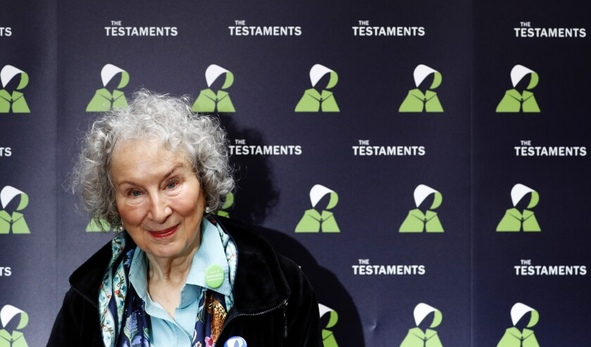 "FILE - In this Tuesday, Sept. 10, 2019 file photo, Canadian author Margaret Atwood poses for a photograph during a press conference at the British Library to launch her new book 'The Testaments' in London. Booker Prize winner Margaret Atwood is the bookies' favorite to win the coveted fiction trophy again for ""The Testaments,"" her follow-up to dystopian saga ""The Handmaid's Tale."" Atwood is one of six finalists for the 50,000-pound ($63,000) prize, whose winner will be announced Monday Oct. 14, 2019. (AP Photo/Alastair Grant, File)"