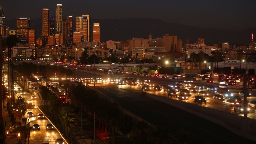 The skyline of Los Angeles, which will have a relatively early solstice sunset at 8:08 p.m. Monday. As the sun appears to drop into the ocean, a full moon will be rising in the east, which is unrelated to the solstice.