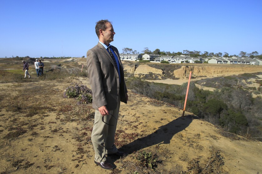 Coastal Commission commissioner and Executive Director Charles Lester takes a tour with coastal commissioners, staff, developers and general public during a field trip tour at the proposed development project at Banning Ranch near Newport Beach on June 11, 2014.