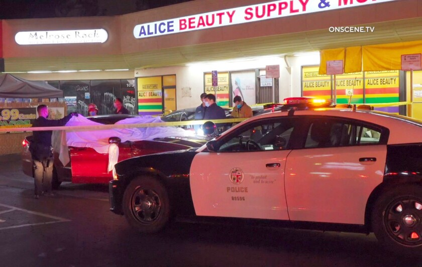 An LAPD patrol car sits outside a strip mall in Arlington Heights.