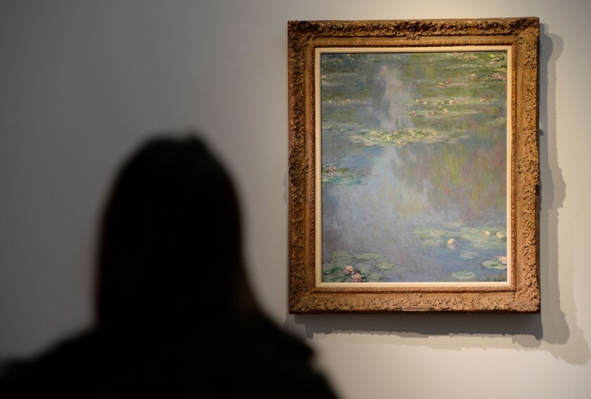 """Claude Monet's """"Nympheas"""", painted in 1907, on display during an auction preview at Christie's in New York."""