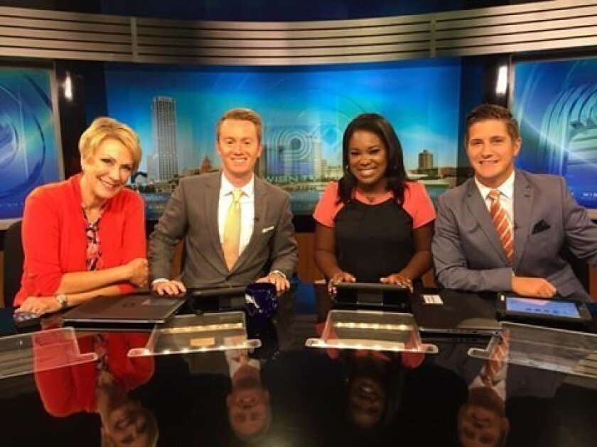 "Chase Cain posted this photo on Facebook Aug. 12 noting, ""We all wore shades of orange & coral this morning ... and we didn't even plan it! — with Sally Severson, Melinda Davenport and Tim Elliott at Channel 12."" Cain is second from left."