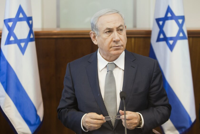 Israeli Prime Minister Benjamin Netanyahu listens during the weekly cabinet meeting in Jerusalem. Sunday, Feb. 14, 2016. (AP Photo/Dan Balilty, Pool)