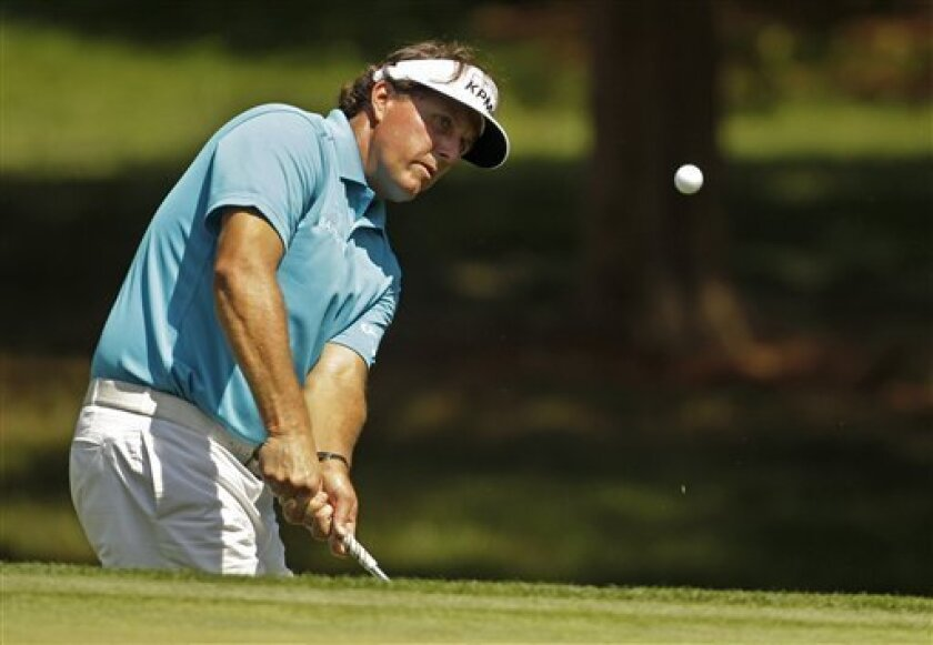Phil Mickelson, shown during a recent tournament, is interested in owning the Padres. (AP Photo/Chuck Burton)