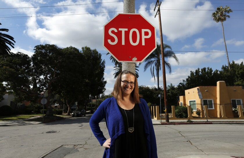 Susie Powell at the Hollywood  intersection of Waring Avenue and McCadden Place, where she helped save the life of a man having a heart attack.