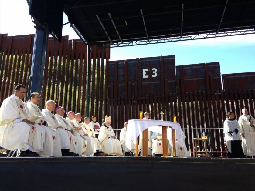 Roman Catholic bishops celebrate Mass at the border fence in Nogales, Ariz., on April 1.
