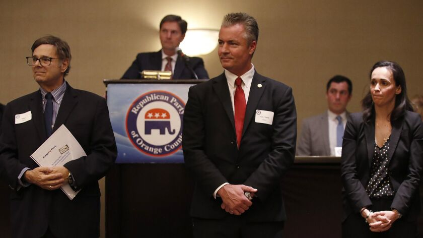 Steve Frank, left, Travis Allen and Jessica Patterson, candidates for chair of the California Republican Party, attend a meeting of Orange County Republicans in Costa Mesa in January.