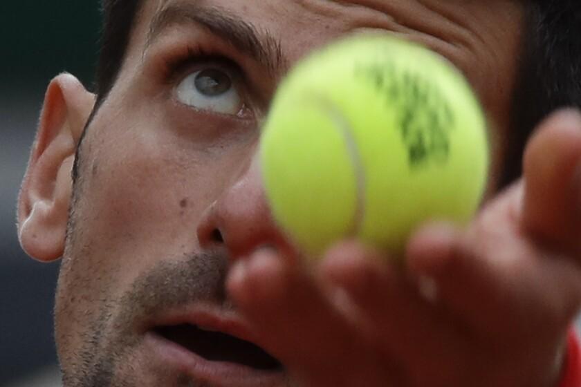 Serbia's Novak Djokovic serves against Lithuania's Ricardas Berankis in the second round match of the French Open tennis tournament at the Roland Garros stadium in Paris, France, Thursday, Oct. 1, 2020. (AP Photo/Alessandra Tarantino)