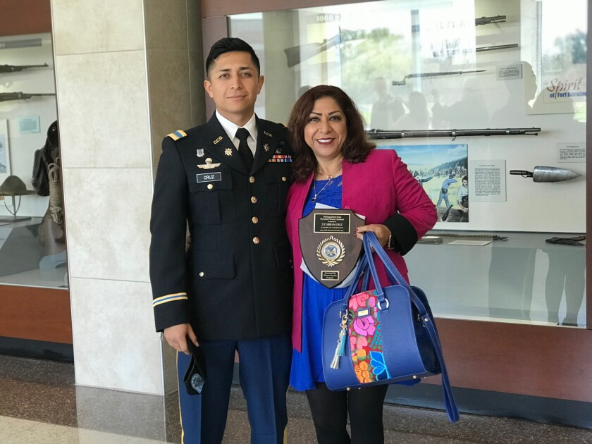 Rocio Rebollar Gomez, 50, with her son Gibram Cruz in Georgia after Cruz graduated from Officer Candidate School.