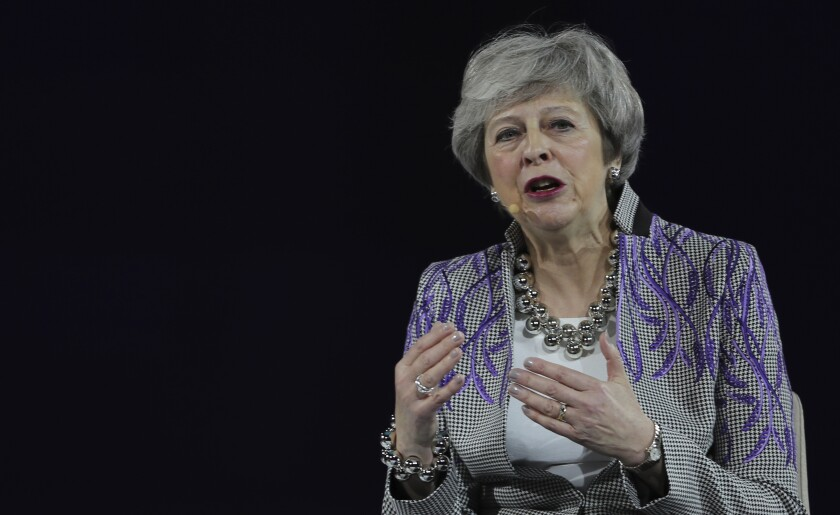 """FILE - In this Monday, Feb. 17, 2020 file photo, former British Prime Minister Theresa May speaks at the Global Women's Forum in Dubai, United Arab Emirates. The British government on Monday Sept. 21, 2020, has won over some domestic political opponents of its plan to breach part of the Brexit divorce deal it agreed with the European Union. But former Prime Minister Theresa May has warned that the bill will do """"untold damage"""" to the U.K. (AP Photo/Kamran Jebreili, File)"""