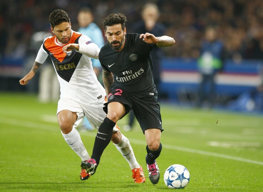 FILE  - This is a Tuesday, Dec. 8, 2015 file photo of PSG's Ezequiel Lavezzi, right, as he goes past  Shakhtar's, Marlos during the Champions League Group A soccer match between PSG and FC Shakhtar Donetsk at the Parc des Princes stadium in Paris. Chinese Super League club Hebei China Fortune said
