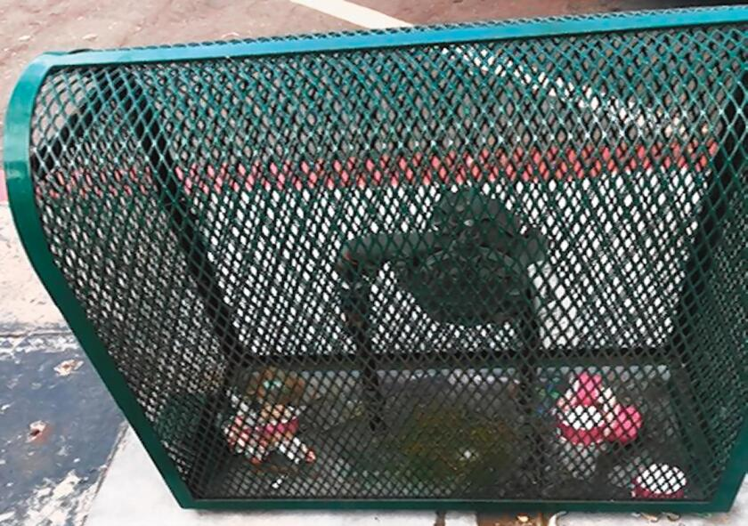 This image of trash purposefully inserted inside a metal grill/cage on Girard Avenue in La Jolla was taken on 2019 Labor Day afternoon.