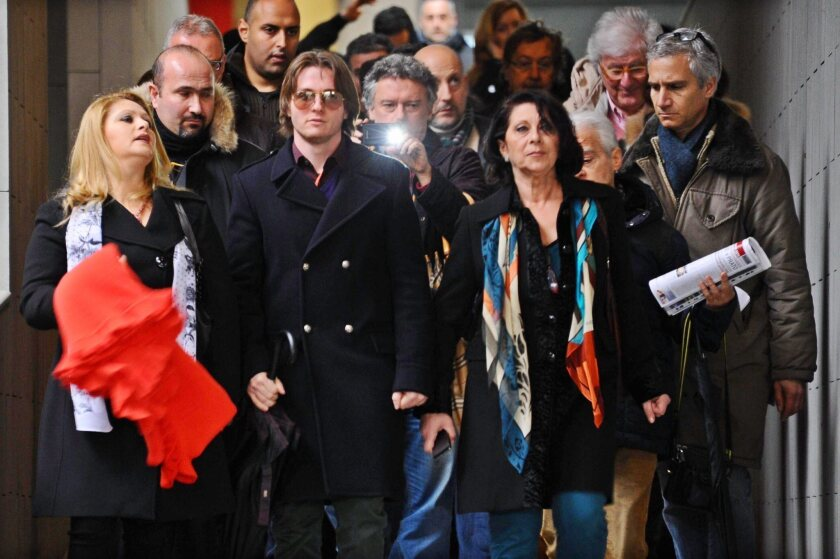 Amanda Knox's ex-boyfriend, Raffaele Sollecito, second from left, leaves an appeals court in Florence, Italy.