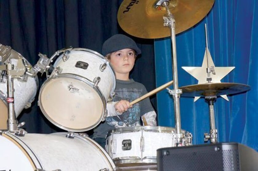 First-grader Dylan Howard rocked the house with his drum solo, 'Back in Black.'
