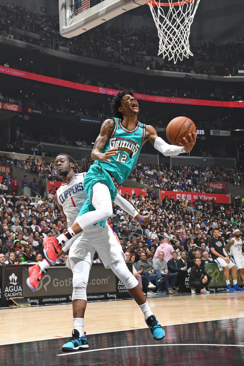 Memphis rookie Ja Morant puts up a shot in front of Clippers' Reggie Jackson.